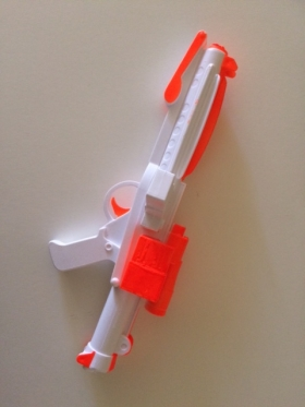 Toy gun with orange markings